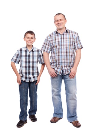 two boys: Father and son standing next to each other, isolated on white background Stock Photo