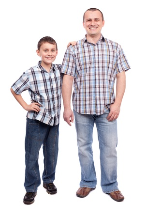dad and son: Father and son standing next to each other, isolated on white background Stock Photo