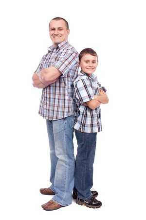 Father and son standing next to each other, isolated on white background photo