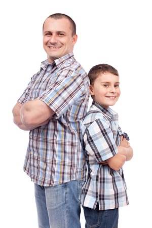 Father and son standing back to back, isolated on white background photo