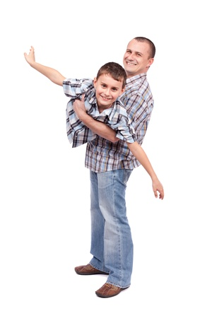 father and child: Father holding his son, isolated on white background