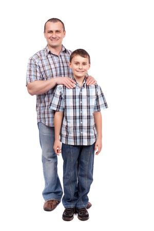 dads: Father and son standing next to each other, isolated on white background Stock Photo
