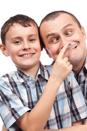 Cute kid and his dad making funny faces, isolated on white background photo