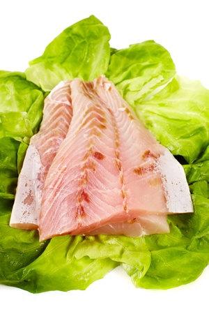 Closeup of raw zander fillets on fresh lettuce photo