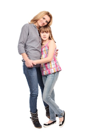 Full length portrait of a mother and her daughter isolated on white background