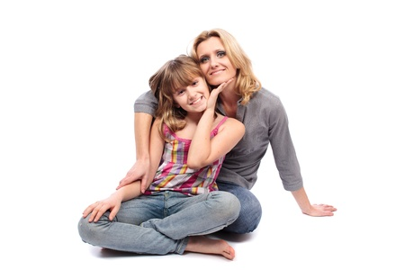 Portrait of a mother with her daughter isolated on white background photo