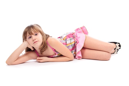 Little girl layed down, isolated on white background Stock Photo - 9190323