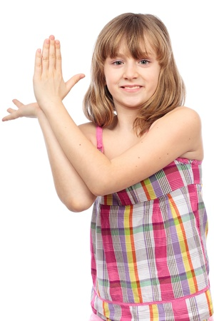 Closeup of a cute girl clapping her hands, isolated on white background Stock Photo - 9190226