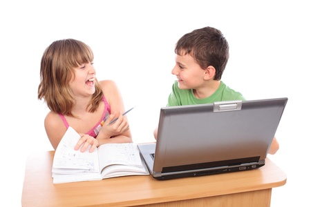 Two school children doing homework together with computer, isolated on white background photo