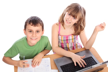 Two school children doing homework together with computer, isolated on white background Stock Photo - 9190227