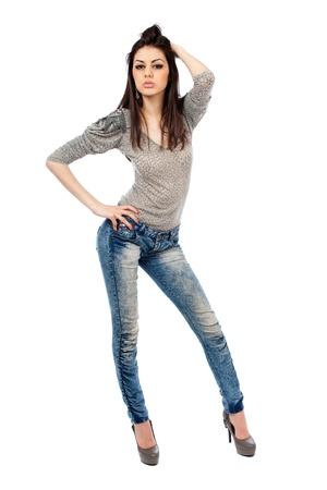 piernas con tacones: Retrato de longitud completa de una hermosa mujer hispana aislada sobre fondo blanco Foto de archivo