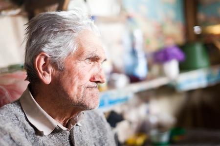 Indoor closeup portrait of an expressive senior farmer with selective focus Stock Photo - 9412263