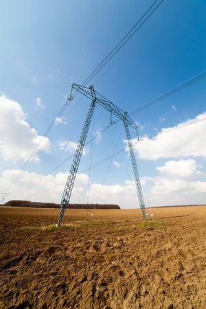 Landscape with big power lines against the blue sky Stock Photo - 9412674