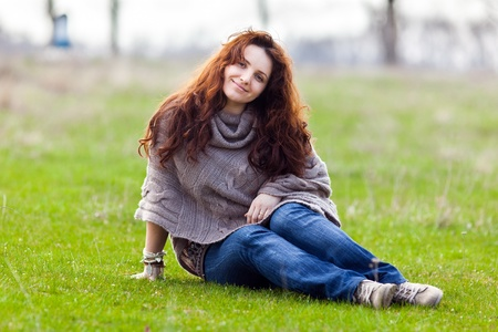Closeup portrait of an attractive young lady outdoor on a meadow photo