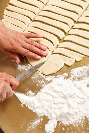 Hands of a woman shaping the dough for preparing cookies Stock Photo - 9502023