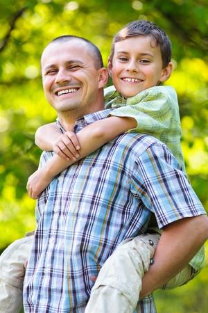 Father giving his son a piggyback ride, having fun Stock Photo - 9619378