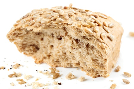 Closeup of whole grain bread with sunflower seeds isolated on white background Stock Photo - 9621610