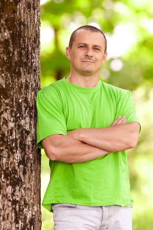 Portrait of a happy young man in a forest Stock Photo - 9619359