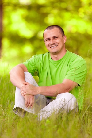 Portrait of a young man relaxing in the forest photo