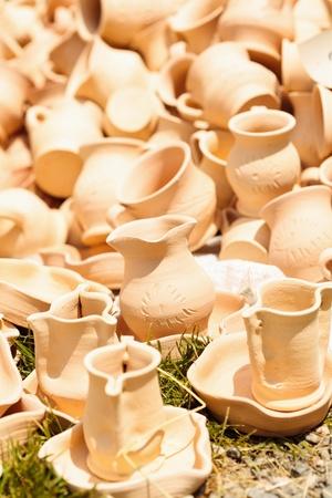 Traditional Romanian earthenware pottery at Horezu ceramic pottery fair in Romania. See the whole series photo