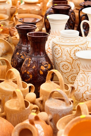 antique dishes: Traditional Romanian earthenware pottery at Horezu ceramic pottery fair in Romania. See the whole series