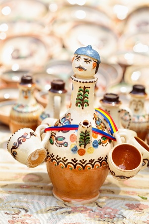 Traditional Romanian earthenware pottery at Horezu ceramic pottery fair in Romania. See the whole series photo
