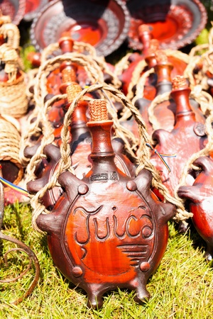 Ceramic pitcher with word Tuica (translation: plum brandy) engraved on it, at Horezu ceramic pottery fair in Romania. See the whole series photo