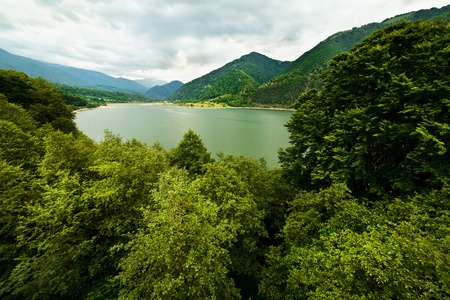 Landscape with lake in mountains in a cloudy day photo