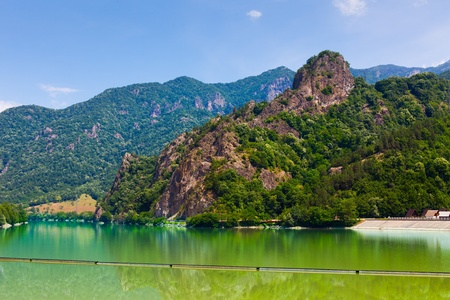 Landscape of Olt Valley with the dam on the Olt river and mountains in Romania photo
