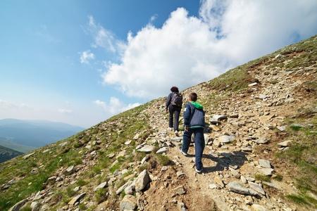 Mountaineer tourists hiking on Iezer peak of Parang mountains in Romania photo