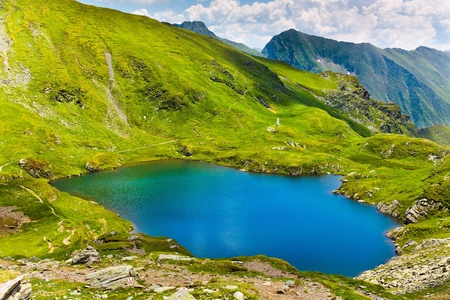 Landscape from Capra Lake in Romania and Fagaras mountains in the summer photo