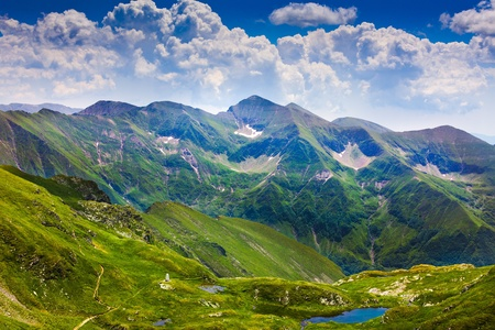 fagaras: Landscape from the rocky Fagaras mountains in Romania in the summer with Capra lake in the distance Stock Photo
