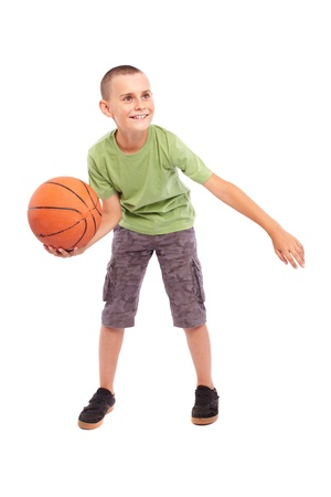 Caucasian Child playing basketball, isolated on white background