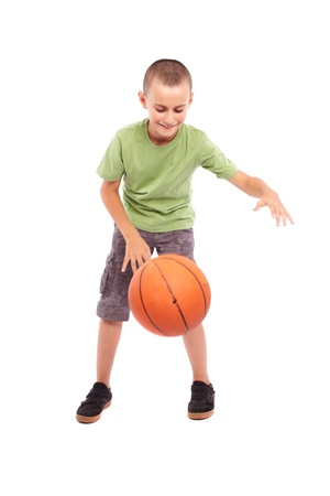 Caucasian child with basketball, isolated on white background photo