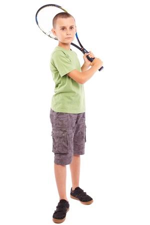 raquet: Child playing training with a field tennis raquet, studio full length portrait Stock Photo