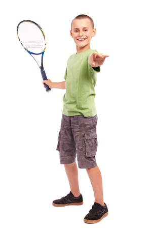 child model: Child playing training with a field tennis raquet, studio full length portrait Stock Photo