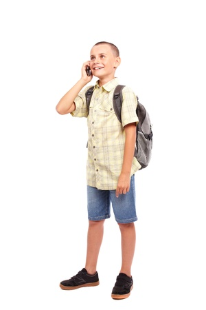 Full length portrait of a schoolchild with backpack isolated on white background photo