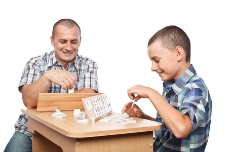 rummy: Father and son playing rummy, isolated on white background