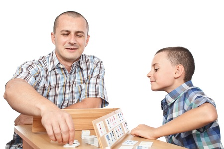 Father and son playing rummy, isolated on white background photo