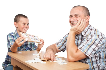 Father and son playing rummy, isolated on white background Stock Photo - 10232159