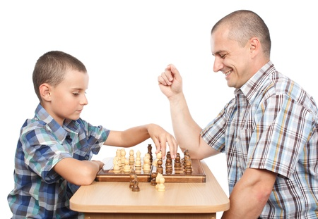Father and son playing chess, isolated on white background photo