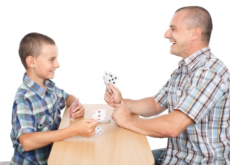 Father and son playing cards, isolated on white background photo