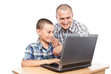 Father and son at the laptop, isolated on white background Stock Photo