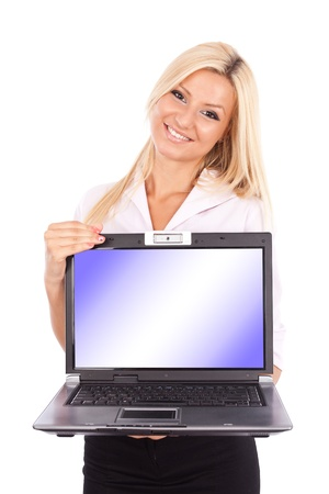 Attractive blond and young businesswoman showing a laptop screen with copyspace photo