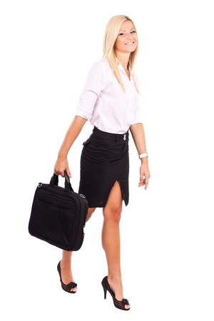 skirt suit: Full length portrait of a friendly businesswoman with briefcase isolated on white background