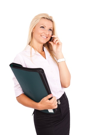 Portrait of a friendly businesswoman with a folder, speaking on mobile phone isolated on white background Stock Photo - 10355989