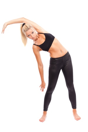 Young woman doing aerobics and stretching, isolated on white background