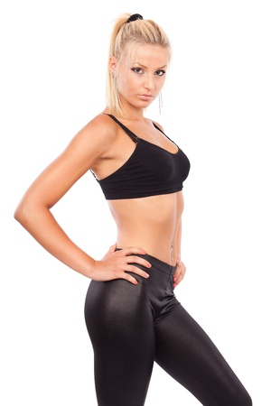 squat: Young woman doing aerobics and stretching, isolated on white background