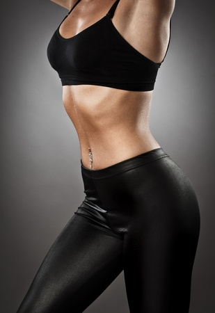girl in sportswear: Studio shot of a very fit athletic woman