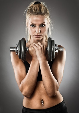 Young woman doing workout with weights, studio shot Stock Photo - 10356031